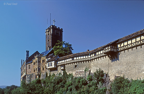[GERMANY.THUERINGEN 33]  'Wartburg, Eisenach.'  After Luther had been banned following his 95 theses against the catholic church, he was abducted. It was a clever move by Friedrich der Weise (Frederick the Wise) - Luther's protector - to have him kidnapped and then hidden in his own castle, disguised as Junker Jörg. Now everyone thought him to be dead.  Luther's stay in the Wartburg has been of great significance for Germany. On Friedrich's advice (who remained catholic himself) Luther set himself to the enormous task of translating the Bible into ordinary German. It helped keep away depression during the months he was isolated in his little room high in the castle. The result wasn't just beneficial to the Reformation, but to the German language as well. Luther had listened to the man in the street to make sure that God's word would be understood. And in doing so he laid the foundation for the modern German language. Photo Paul Smit.