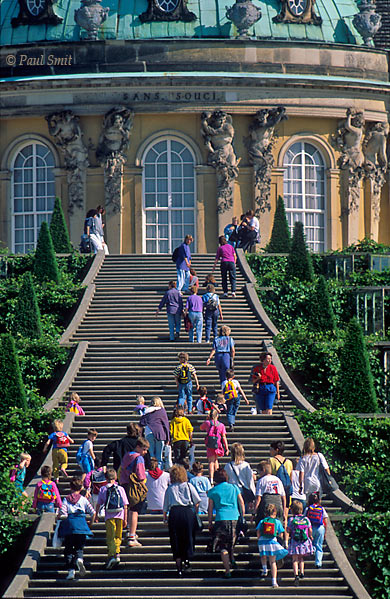 [GERMANY.BRANDENBURG 10]  'Schloss and Park Sanssouci, Potsdam.'  Stairs climbing terraced vineyard garden towards the baroque Sanssouci palace, french for free of worries. This garden is the heart of the much larger, 290 ha Sanssouci Park, that itself is just the centerpiece of a whole chain of parks, gardens and palaces. Friedrich der Große (Frederick the Great) and generations of Prussian kings after him had these parks constructed along the banks of the Havel, a river that widens into an idyllic lake every few kilometers. The park landscape starts at Werder and reaches, via Potsdam, deep into Berlin. In the past the Glienicker Bridge, famous for its exchange of spies, divided this area. Since the German unification you can enjoy it as a whole and it has become a UNESCO World Heritage site. Photo Paul Smit.
