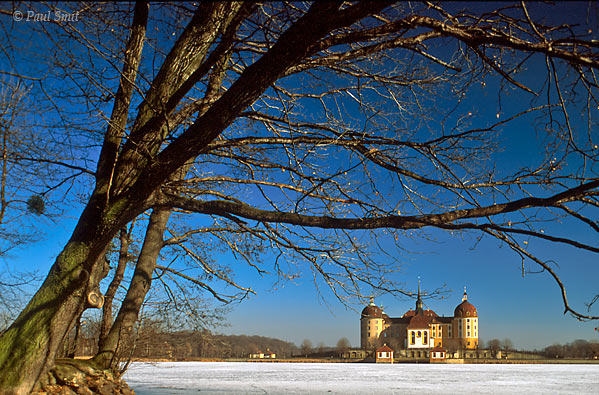 [GERMANY.SACHSEN 43]  'Jachtschloss Moritzburg near Dresden.'  The baroque hunting lodge Moritzburg, situated northwest of Dresden, is surrounded by water in summer. During the winter this turns into ice, resulting in the palace being approachable not only across the bridge, but from all directions ... on skates! The castle and its park used to form the background for baroque parties, organized by August the Strong, elector of Saxonia. Photo Paul Smit.