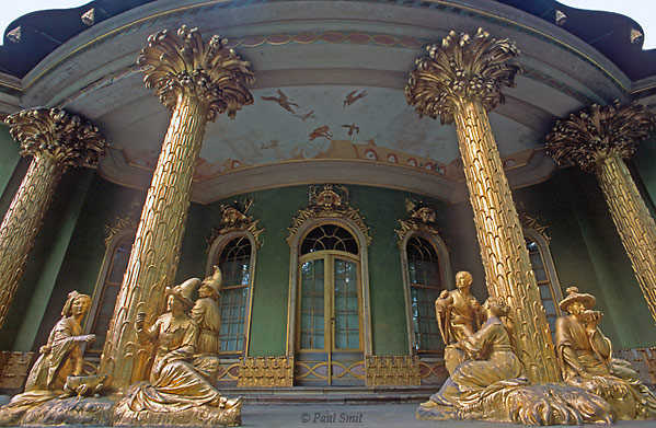 [GERMANY.BRANDENBURG 16]  'Chinese tea pavilion, Park Sanssouci, Potsdam.'  The Prussian kings imported the whole world to Potsdam by copying it. This Chinese tea pavilion was constructed in the baroque Sanssouci Park. China was fashion in those days. English parks were sprinkled with Italian villas some time later. Antique temple ruins were raised on top of a hill - brand new! For powering the fountains steam engines were constructed inside a Moorish mosque, the chimney hidden in the minaret. And a piece of Holland was erected in the middle of Potsdam. They really were mad about copying: not one of the fortyseven Raphaels in their Orangery Palace was real! Photo Paul Smit.