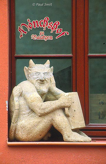 [GERMANY.SACHSEN 7472] 'Devil stays outside.' Café called Mönchshof (House of the Monks) in Bautzen, where a little devil is having his beer outside. Photo Paul Smit.