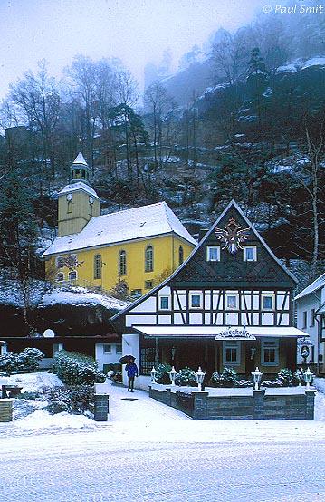 [GERMANY.SACHSEN 7496] 'Oybin.' Church in front of misty Berg Oybin (Oybin Hill) in the Zittauer Gebirge (Hills of Zittau). Photo Paul Smit.