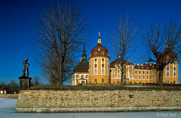 [GERMANY.SACHSEN 7311]  'Jachtschloss Moritzburg near Dresden.'  The baroque hunting lodge Moritzburg, situated northwest of Dresden, is surrounded by water in summer. During the winter this turns into ice, resulting in the palace being approachable not only across the bridge, but from all directions ... on skates! The castle and its park used to form the background for baroque parties, organized by August the Strong, elector of Saxonia. Photo Paul Smit.