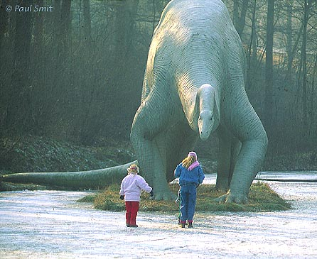 [GERMANY.SACHSEN 7424] 'Curious Diplodocus.' A Diplodocus from the Jura period seems very curious about the children, but being a herbivore he would never harm them. The photo was taken in the Saurierpark (dinosaur park) in Kleinwelka, near Bautzen. The animal was designed and built from concrete by Franz Gruß. Photo Paul Smit.