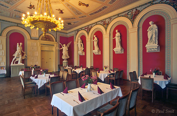 [GERMANY.MECKLENBURG 2]  'Restaurant Rote Saal, Orangery, Schlosspark Neustrelitz.'  The palace of Neustrelitz was destroyed during the last days of the Second World War. But the park, partly baroque, partly English in style, has remained intact. Just like the Orangerie, with roof paintings resembling those of Pompei and copies of antique statues. The best spot to experience the neoclassicist atmosphere is the Rote Saal while you are dining... Photo Paul Smit.