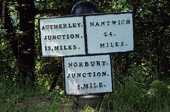 [BRITAIN.ENGMIDDLE 22.160 'Canal signpost.'  A sturdy cast-iron milepost on the bank of the Shropshire Union Canal north of Gnosall helps boaters find their way. Photo Mick Palarczyk.