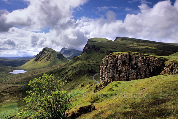 [BRITAIN.HEBRIDES 27793] 'Looking south along the Trotternish Ridge.'  	On Skye's Trotternish Peninsula the steep escarpment of the Trotternish Ridge offers some of the island's most dramatic landscapes. The sloping plateaus consist of large sheets of lava which were erupted when the European continent and America started to drift apart 60 million years ago. After the eruption the horizontal lava sheets were gently tilted to the west. Photo Mick Palarczyk.