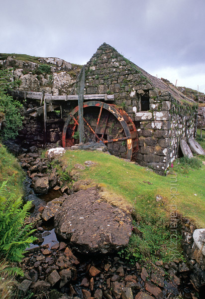 [BRITAIN.HEBRIDES 27821] 'Glendale watermill.'  Glendale watermill is situated at a bay on the west coast of Skye. Via a wooden gutter a small brook delivers its water on the upper part of the iron (overshot) wheel. Crofters once brought their grain by sea, some from as far away as the Outer Hebrides. Photo Mick Palarczyk.