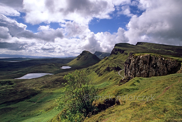 [BRITAIN.HEBRIDES 27796] 'Looking south along the Trotternish Ridge.'  	On Skye's Trotternish Peninsula the steep escarpment of the Trotternish Ridge offers some of the island's most dramatic landscapes. The sloping plateaus consist of large sheets of lava which were erupted when the European continent and America started to drift apart 60 million years ago. After the eruption the horizontal lava sheets were gently tilted to the west. Photo Mick Palarczyk.