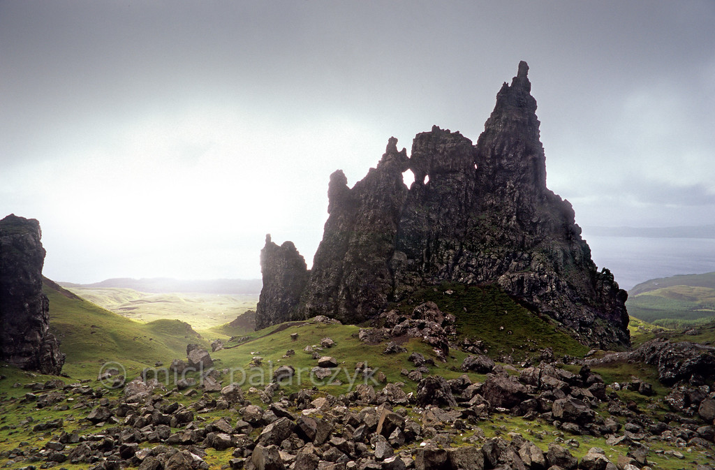 """[BRITAIN.HEBRIDES 27769] 'The Cathedral.'  On Skye's Trotternish Peninsula the basalt pinnacles at the foot of the Storr give a dramatic touch to the landscape. This rock formation is called """"The Cathedral"""" for obvious reasons. In the distance the Sound of Raasay can be seen. Photo Mick Palarczyk."""