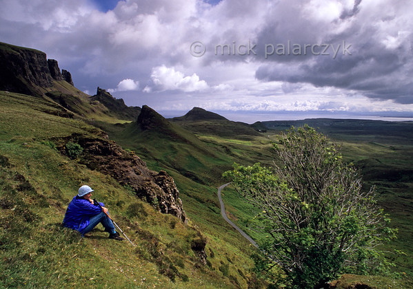 [BRITAIN.HEBRIDES 27802] 'Quiraing.'  	On Skye's Trotternish Peninsula the steep escarpment of the Quiraing offers some of the island's most dramatic landscapes. The hillocks and pinnacles at the foot of the ridge are the result of massive landslides in which layers of basalt lava's slumped down from the top of the escarpment over older relatively weak sedimentary rocks. The Quiraing is a popular trekking destination. Photo Mick Palarczyk.