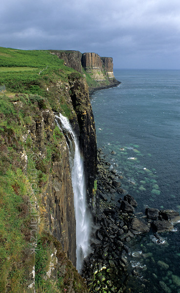 [BRITAIN.HEBRIDES 27789] 'Mealt Waterfall.'  After a rainy period the Mealt Waterfall gushes down the cliffs at the east coast of Skye's Trotternish Peninsula. In the distance the vertical columns of Kilt Rock can be made out. Photo Mick Palarczyk.