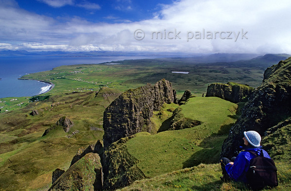 [BRITAIN.HEBRIDES 27806] 'The Table.'  On Skye's Trotternish Peninsula the steep escarpment of the Quiraing offers some of the island's most dramatic landscapes. From the top of the ridge you have a nice few of 'The 'Table', a strange grassy platform that was formed as a result of a massive landslide in which part of the escarpment slumped down. To the left Staffin Bay is visible. Photo Mick Palarczyk.