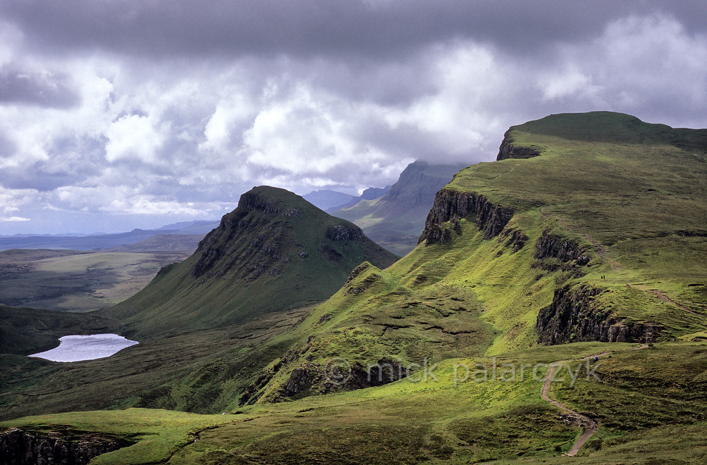 [BRITAIN.HEBRIDES 27797] 'Looking south along the Trotternish Ridge.'  On Skye's Trotternish Peninsula the steep escarpment of the Trotternish Ridge offers some of the island's most dramatic landscapes. The sloping plateaus consist of large sheets of lava which were erupted when the European continent and America started to drift apart 60 million years ago. After the eruption the horizontal lava sheets were gently tilted to the west. Photo Mick Palarczyk.