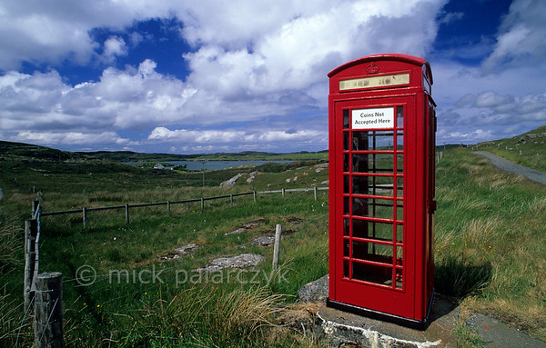 [BRITAIN.HEBRIDES 27702] 'Telephone booth.'  	An isolated telephone booth overlooks the northern shore of the Isle of Lewis near the village of Crulivig. Photo Mick Palarczyk.