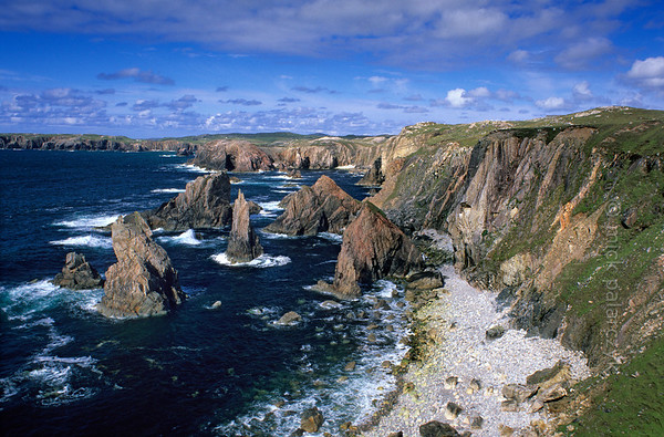 [BRITAIN.HEBRIDES 27663] 'Aird Fenish.'  	The seastacks of Aird Fenish, on the western shore of Lewis, offer some of the most spectacular coastal scenery of the Hebrides. Photo Mick Palarczyk.
