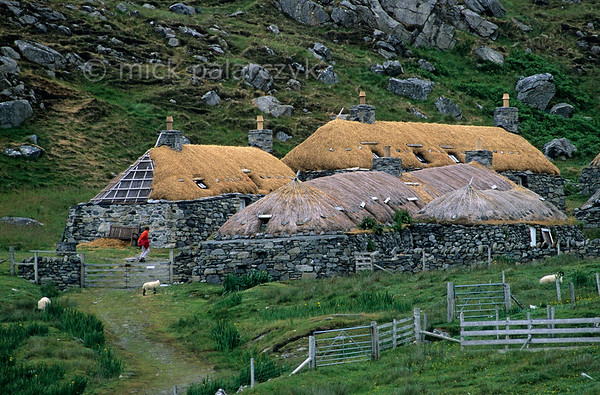 """[BRITAIN.HEBRIDES 27706] 'Gearrannan blackhouse village.'  The village of Gearrannan is located at a small bay on the northern coast of the Isle of Lewis. The last aging residents left the 17th century village in the 1970s. Its """"blackhouses"""" have now been lovingly restored and house a youth hostel, a museum and self-catering accommodation. Photo Mick Palarczyk."""