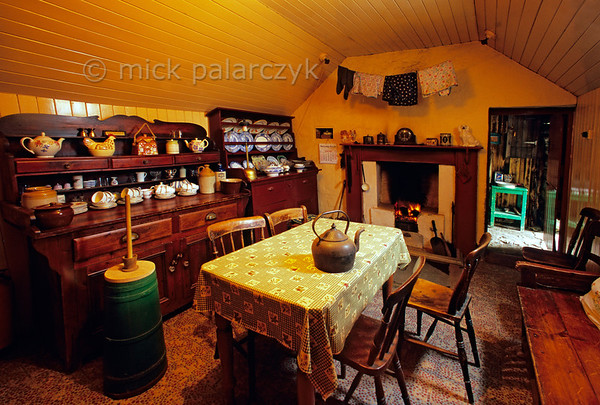 [BRITAIN.HEBRIDES 27709] 'Interior of blackhouse in Gearrannan village.'  	The village of Gearrannan is located at a small bay on the northern coast of the Isle of Lewis. The last ageing residents left the 17th century village in the 1970s. It has now been lovingly restored and houses a youth hostel, self-catering accommodation and -seen here - a blackhouse which retains its original 1955 interior. Photo Mick Palarczyk.