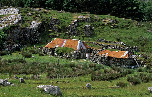 [BRITAIN.HEBRIDES 27700] 'Rusty roofs.'  	Rusty roofs provide a nice contrast with the green surroundings near the village of Crulivig, on the northern shore of the Isle of Lewis. Photo Mick Palarczyk.