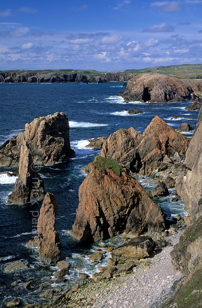 [BRITAIN.HEBRIDES 27664] 'Aird Fenish.'  	The seastacks of Aird Fenish, on the western shore of Lewis, offer some of the most spectacular coastal scenery of the Hebrides. Photo Mick Palarczyk.