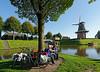 HOLLAND.FRIESLAND 30268] 'Cyclist near windmill 'Zeldenrust' in Dokkum'.