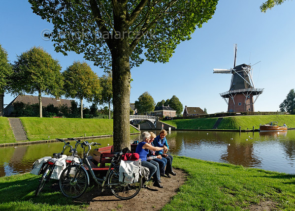 HOLLAND.FRIESLAND 30268] 'Cyclist near windmill 'Zeldenrust' in Dokkum'.