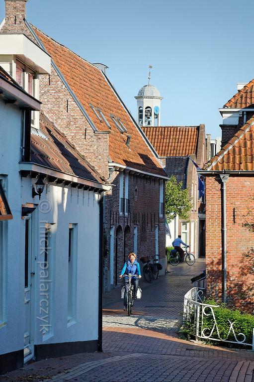 HOLLAND.FRIESLAND 30266] 'Cyclist in Dokkum'.