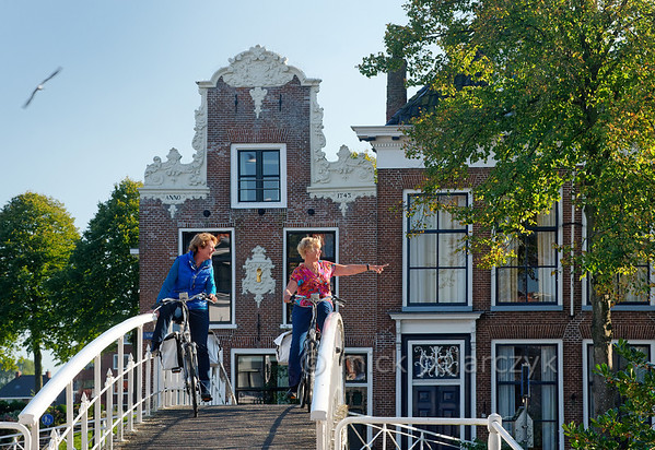 HOLLAND.FRIESLAND 30263] 'Cyclists in Dokkum'.