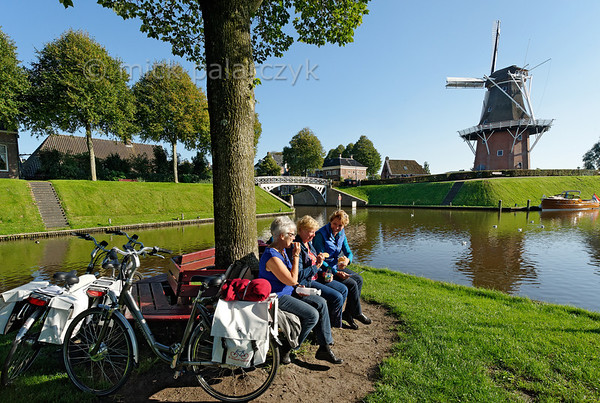 HOLLAND.FRIESLAND 30269] 'Cyclist near windmill 'Zeldenrust' in Dokkum'.