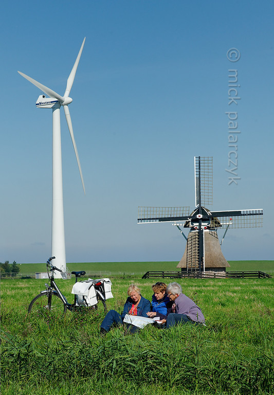 HOLLAND.FRIESLAND 30251] 'Cyclists near old and new mill'.
