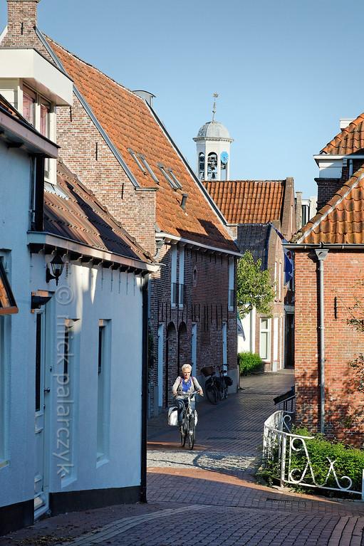 HOLLAND.FRIESLAND 30267] 'Cyclist in Dokkum'.