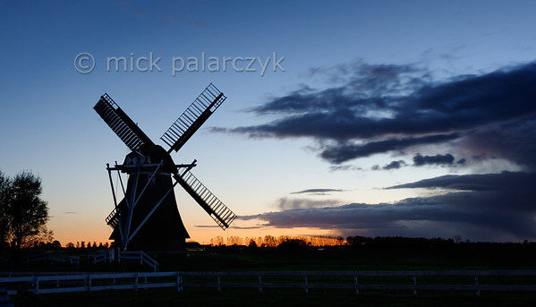 [HOLLAND.GRONINGEN 29503] 'Windmill Westerhornermolen near Grijpskerk'  	The silhouette of the 'Westerhornermolen' south of Grijpskerk stands out dramatically against the evening sky. The wooden mill was built in 1829 to drain water from the surrounding land. Photo Mick Palarczyk.