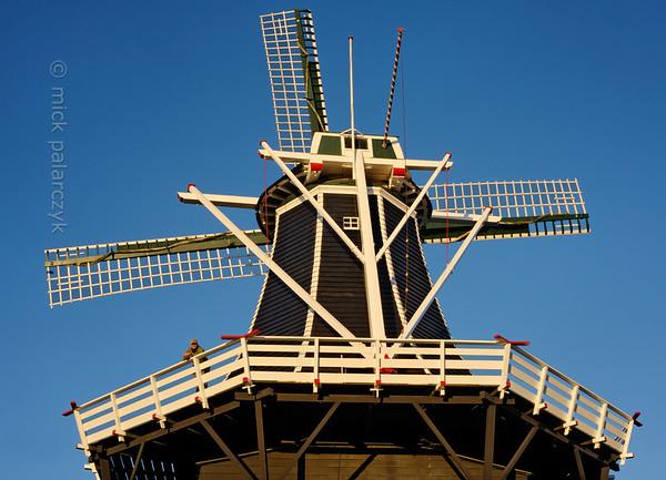 [HOLLAND.GRONINGEN 29499] 'Windmill De Kievit in Grijpskerk'  Windmill De Kievit (The Lapwing) can be found at the northwestern edge of the village of Grijpskerk. The wooden tower mill (Dutch: stellingmolen) was built in 1899 and has working corn grinding machinery. Photo Mick Palarczyk.