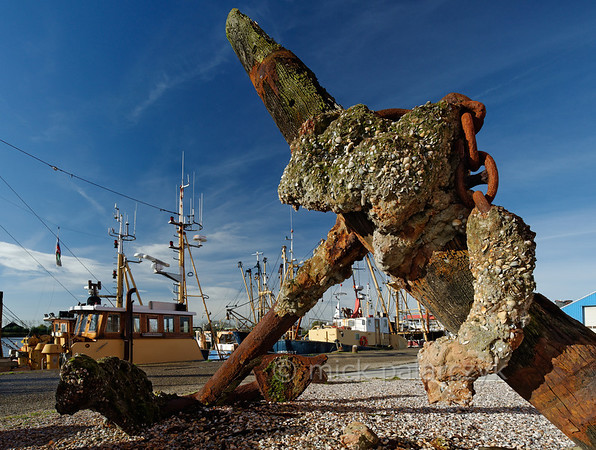 [HOLLAND.GRONINGEN 29435] 'Anchor in Zoutkamp.'  	An old wooden and iron anchor encrusted with mollusks can be found in the harbour of Zoutkamp. Photo Mick Palarczyk.
