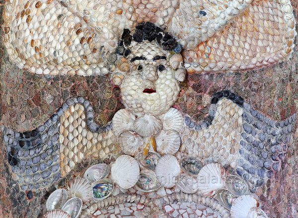 [HOLLAND.GRONINGEN 29481] 'Angel in shell grotto at Leek.'  	A winged angel's heads decorates the eastern wall of a garden-house on the Nienoord Estate near the village of Leek. The interior of this garden house has been decorated with mosaics of mollusks around 1700 AD by Italian craftsmen. Local Dutch shells as well as tropical specimens have been used. Here we can see that the angel's wings are made with mussels. Photo Mick Palarczyk.