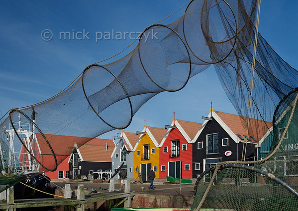 [HOLLAND.GRONINGEN 29437] 'Eel nets in Zoutkamp.'  Eel nets hang out to dry in the harbour of Zoutkamp. Eel nets need to be cleaned once a week because they can retain an odour which will shy away the eel. Photo Mick Palarczyk.