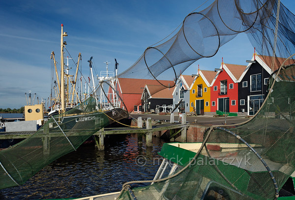 [HOLLAND.GRONINGEN 29436] 'Eel nets in Zoutkamp.'  	Eel nets hang out to dry in the harbour of Zoutkamp. Eel nets need to be cleaned once a week because they can retain an odour which will shy away the eel. Photo Mick Palarczyk.