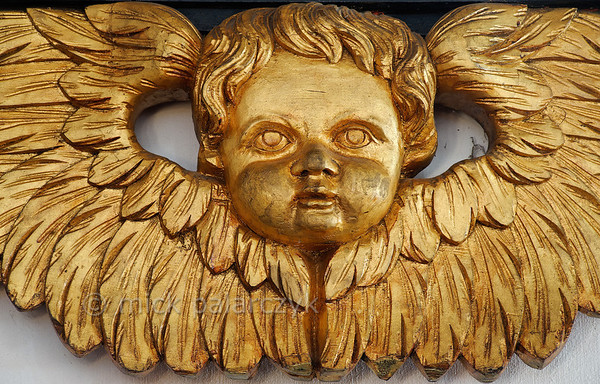 [HOLLAND.GRONINGEN 29496] 'Gilded angel in Midwolde.'  The interior of the church of Midwolde is decorated by several hatchments (Dutch: rouwborden). This gilded angel is part of a hatchment dating from 1737. Photo Mick Palarczyk.