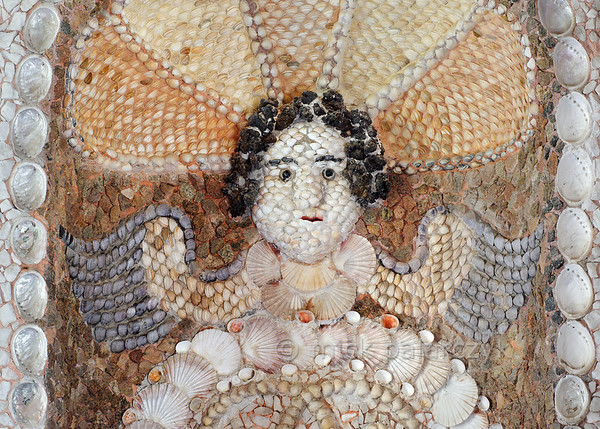 [HOLLAND.GRONINGEN 29479] 'Angel in shell grotto at Leek.'  	A winged angel's heads decorates the eastern wall of a garden-house on the Nienoord Estate near the village of Leek. The interior of this garden house has been decorated with mosaics of mollusks around 1700 AD by Italian craftsmen. Local Dutch shells as well as tropical specimens have been used. Here we can see that the angel's wings are made with mussels. Photo Mick Palarczyk.