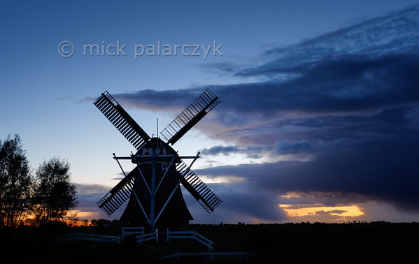 [HOLLAND.GRONINGEN 29502] 'Windmill Westerhornermolen near Grijpskerk'  	The silhouette of the 'Westerhornermolen' south of Grijpskerk stands out dramatically against the evening sky. The wooden mill was built in 1829 to drain water from the surrounding land. Photo Mick Palarczyk.