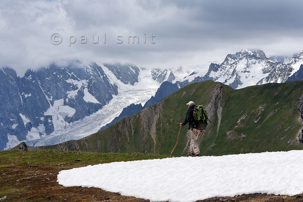 Hiker and the Brenva glacier, Mont Blanc.
