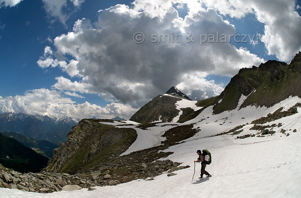 Hiker crossing snow field near Col de Vessonaz.