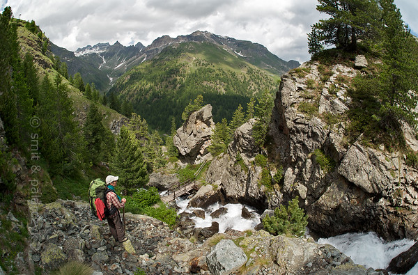 Hiker overlooking a waterfall.