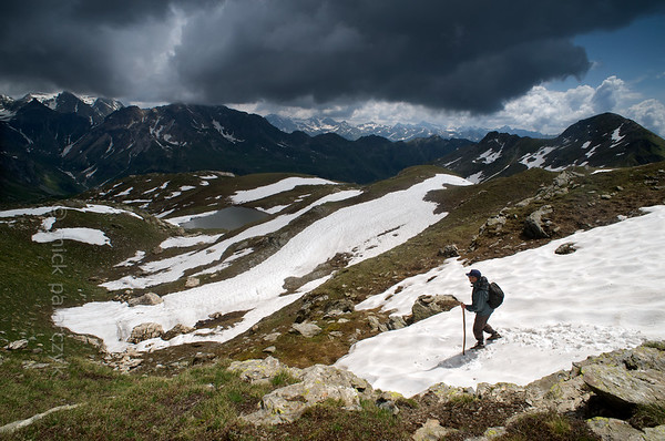 Hiker crossing snow fields Col de Chaleby.