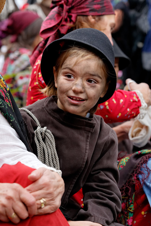 [ITALY.PIEMONTE 11039] 'Little chimney sweep in Malesco.'  During the International Chimney Sweeps Gathering (Raduno Internazionale dello Spazzacamino) in Valle Vigezzo you not only see real chimney sweeps but also people from the valley putting on traditional dress to celebrate the old days. Nowadays, as folklore, that past looks as if it was happy. But in reality Valle Vigezzo was extremely poor and many children (boys, not girls) had to leave home in winter to live the hard and hungry life of little chimney sweeps in the cities of the Po plain. Photo Paul Smit.