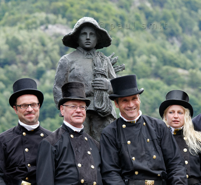 [ITALY.PIEMONTE 11033] 'German chimney sweeps in Malesco.'  Four German chimney sweeps, gathered around the Monument of the Little Chimney Sweep in Malesco, Valle Vigezzo, pose for a group photo during the International Chimney Sweeps Gathering (Raduno Internazionale dello Spazzacamino). Photo Paul Smit.