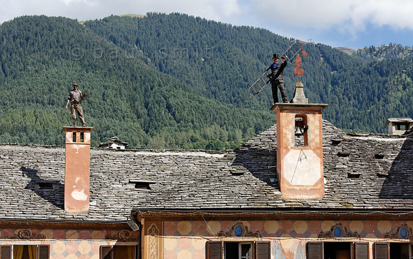 [ITALY.PIEMONTE 11088] 'Chimney sweeps on the roof of the town hall in Santa Maria Maggiore.'  Italian (left) and Swedish chimney sweep on the roof of the town hall in Santa Maria Maggiore during the International Chimney Sweeps Gathering (Raduno Internazionale dello Spazzacamino) in Valle Vigezzo. Photo Paul Smit.