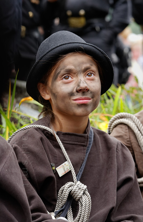 [ITALY.PIEMONTE 11038] 'Girl dressed as Chimney Sweep.'  During the International Chimney Sweeps Gathering (Raduno Internazionale dello Spazzacamino) in Valle Vigezzo you not only meet real chimney sweeps but also children dressed like the little chimney sweeps from the old days. Nowadays, as folklore, that past looks as if it was happy. But in reality Valle Vigezzo was extremely poor and many children (boys, not girls) had to leave home in winter to live the hard and hungry life of chimney sweeps in the cities of the Po plain. Photo Paul Smit.