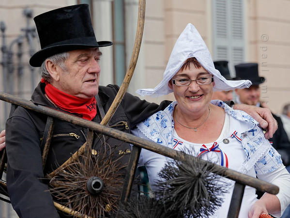 [ITALY.PIEMONTE 11052] 'Swiss chimney sweep and woman in Dutch traditional dress.'  During the International Chimney Sweeps Gathering (Raduno Internazionale dello Spazzacamino) in Valle Vigezzo a Swiss chimney sweep poses with the wife of a Dutch colleague in more or less traditional dress. The retired chimney sweep carries the actual tools he used when he was younger. Photo Paul Smit.