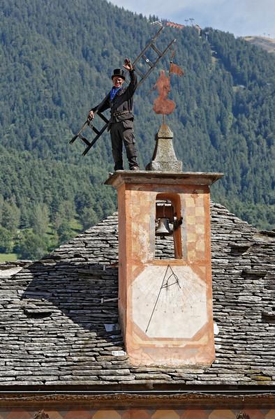 [ITALY.PIEMONTE 11090] 'Chimney sweep on the roof of the town hall in Santa Maria Maggiore.'  Swedish chimney sweep on the roof of the town hall in Santa Maria Maggiore during the International Chimney Sweeps Gathering (Raduno Internazionale dello Spazzacamino) in Valle Vigezzo. Photo Paul Smit.